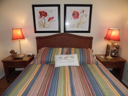 Click to enlarge image Master bedroom with queen bed - BeeGee's Redfish Quarters - Large 2 bedroom, 2.5 bath with tile and laminate floors, private laundry, Dog Friendly. Walk to the beach. Covered Patio.