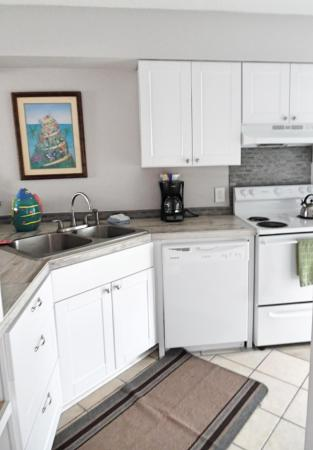 Click to enlarge image Bright new kitchen - BeeGee's Redfish Quarters - Large 2 bedroom, 2.5 bath with tile and laminate floors, private laundry, Dog Friendly. Walk to the beach. Covered Patio.
