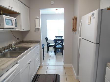 Click to enlarge image From kitchen to the dining area - Tarpon Quarters - One bedroom, with king bed, one bath. LARGE condo with laundry, tile floors, Dog Friendly.Walk to the beach.