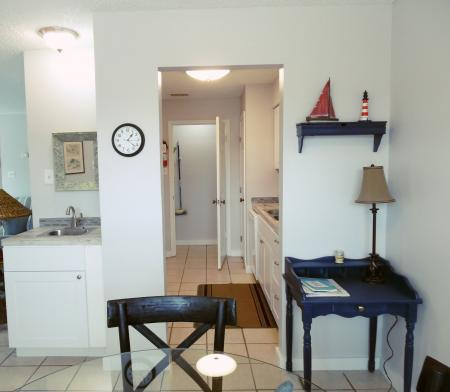 Click to enlarge image From the dining room through the kitchen - Tarpon Quarters - One bedroom, with king bed, one bath. LARGE condo with laundry, tile floors, Dog Friendly.Walk to the beach.