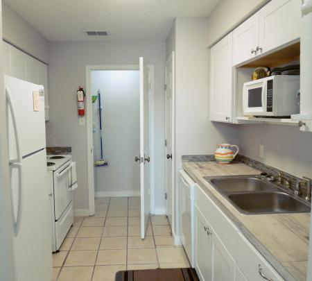Click to enlarge image Looking at kitchen and laundry room - Tarpon Quarters - One bedroom, with king bed, one bath. LARGE condo with laundry, tile floors, Dog Friendly.Walk to the beach.