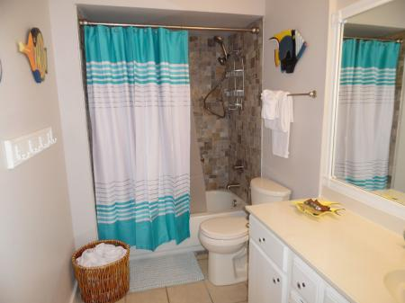 Click to enlarge image New tub and tile surround - Tarpon Quarters - One bedroom, with king bed, one bath. LARGE condo with laundry, tile floors, Dog Friendly.Walk to the beach.