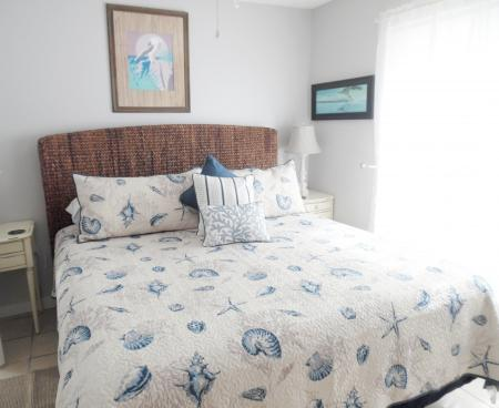 Click to enlarge image Comfy king bed - Tarpon Quarters - One bedroom, with king bed, one bath. LARGE condo with laundry, tile floors, Dog Friendly.Walk to the beach.