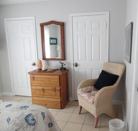 Click to enlarge image Two large closets and tv in bedroom - Tarpon Quarters - One bedroom, with king bed, one bath. LARGE condo with laundry, tile floors, Dog Friendly.Walk to the beach.
