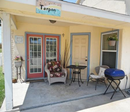 Click to enlarge image Shady welcoming Tarpon Quarters patio - Tarpon Quarters - One bedroom, with king bed, one bath. LARGE condo with laundry, tile floors, Dog Friendly.Walk to the beach.