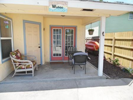 Click to enlarge image Shady back patio for relaxing after a day at the beach - Wahoo Quarters - One bedroom, one bath, LARGE condo with laundry, tile floors, Dog Friendly. Walk to beach