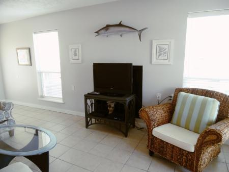 Click to enlarge image Extra seating for guests and a Wahoo on the wall! - Wahoo Quarters - One bedroom, one bath, LARGE condo with laundry, tile floors, Dog Friendly. Walk to beach