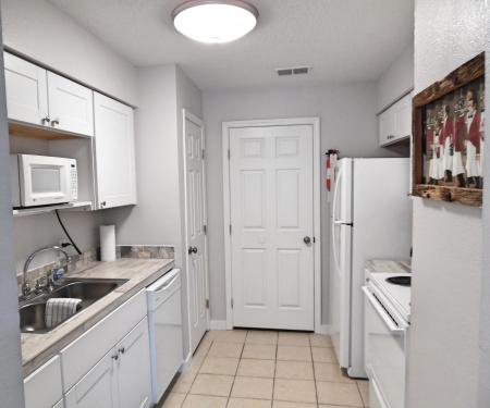 Click to enlarge image Remodeled kitchen and laundry room - Wahoo Quarters - One bedroom, one bath, LARGE condo with laundry, tile floors, Dog Friendly. Walk to beach