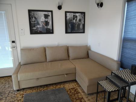 Click to enlarge image Living room couch converts to full size bed - La Perla, Gorgeous remodel, 1 BR 1 BA Cottage, Fenced Yard, Backyard Oasis -