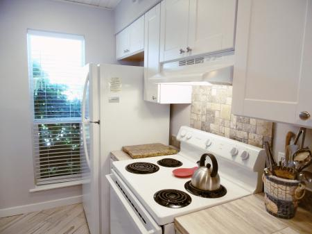 Click to enlarge image Full sized fridge and electric stove - Trout Quarters - 2 Bedroom townhouse 3 blocks from the beach