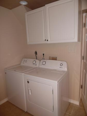 Click to enlarge image Full sized washer and dryer in the bathroom - LOVE'S NEST - 2 BR 1 BA Lower Apartment. Walk to the beach!
