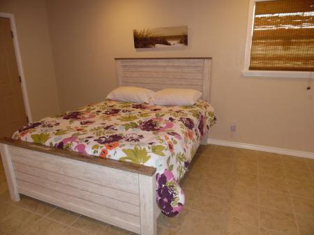 Click to enlarge image Larger of the queen bedrooms - LOVE'S NEST - 2 BR 1 BA Lower Apartment. Walk to the beach!