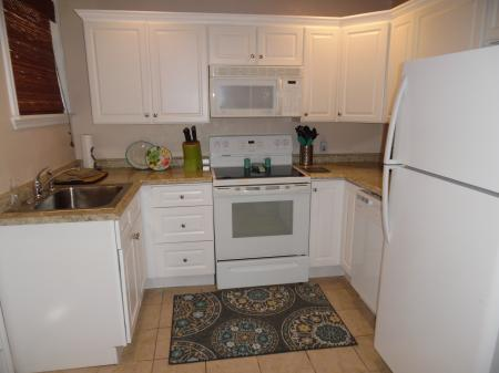 Click to enlarge image Fully stocked kitchen - LOVE'S NEST - 2 BR 1 BA Lower Apartment. Walk to the beach!