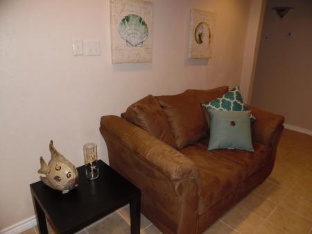 Click to enlarge image Loveseat across from sofa - LOVE'S NEST - 2 BR 1 BA Lower Apartment. Walk to the beach!