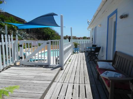 Click to enlarge image Deck to the pool - Cottage in the Dunes - One Bedroom Cottage with pool