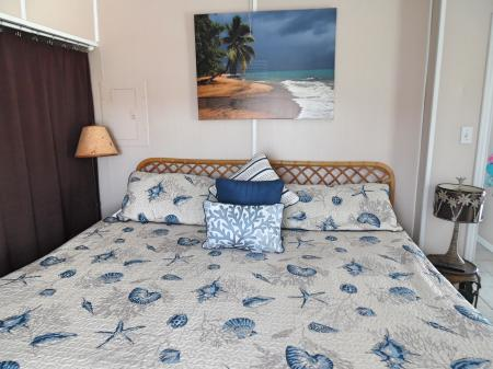 Click to enlarge image Comfy king bed - Cottage in the Dunes - One Bedroom Cottage with pool